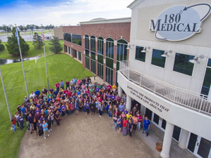 180 Medical employees in front of building