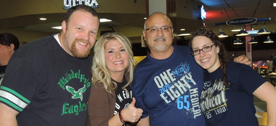 180 Medical Employees smiling at an Annual Bowling event