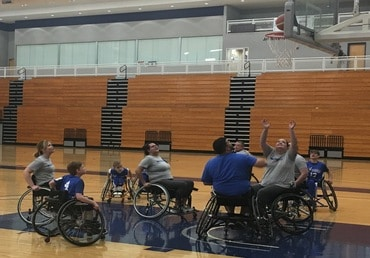 playing adaptive wheelchair basketball
