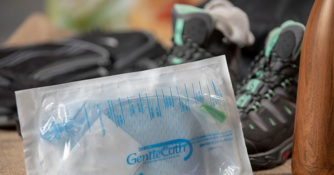 GentleCath Pro Closed System Catheter with hiking gear