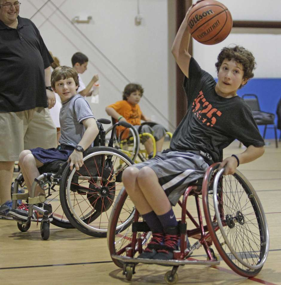 Aaron and Peter Berry discover wheelchair basketball