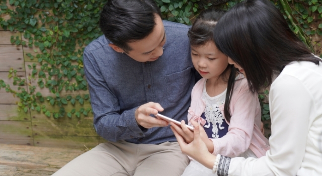 image of parents talking to child
