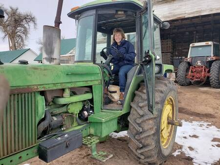 Michele driving a tractor