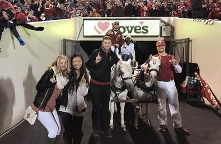 Lindsay with OU Sooners horses