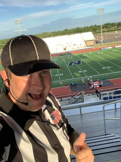 Tyler refereeing a North Edmond football game